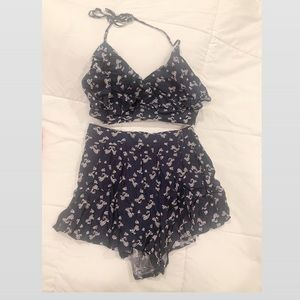 Two piece short and halter crop top set.